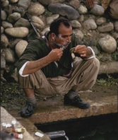 Colonel Akrawi shaving, Iraqi Kurdistan, June 1965
