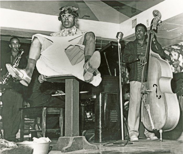 Entertainers in a Bourbon Street nightclub: some clowning is traditional among New Orleans musicians, but in the commercial joints they often faced degrading conditions.  Bassist at right is jazzman James Prevost. Prior to 1960. Courtesy Hogan Jazz Archive, Tulane University