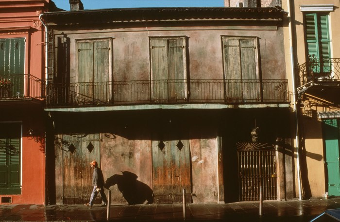 Preservation Hall, St. Peter Street, French Quarter, New Orleans, early morning, after the streets have been freshly washed and workers are filtering back to their jobs in the tourist industry. Photograph by William Carter, 1984
