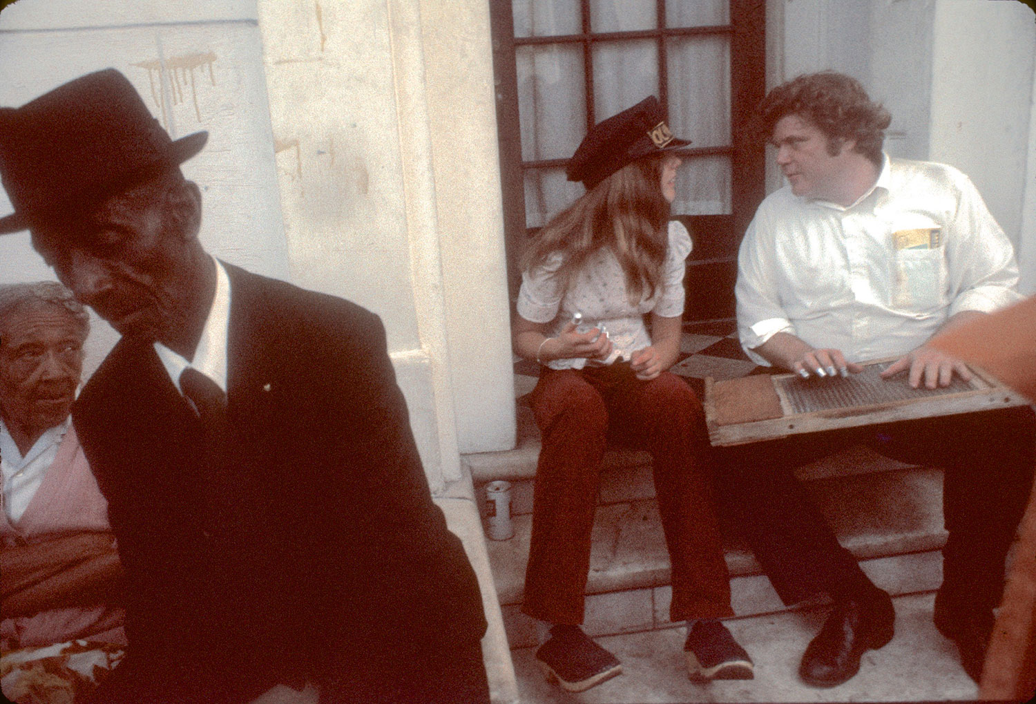 Serenading a friend of the musicians, Miss Carrie, at her home typified the informality of French Quarter musical culture. Left to right: Miss Carrie; bass drummer Booker T. Glass; student Jennifer Hamilton wearing band hat; washboard player Allan Jaffe. Photograph by William Carter, 1974
