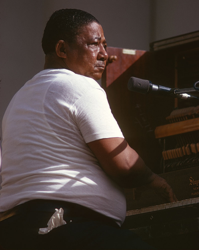 """Pianist-vocalist Sing Miller at concert; """"You gotta have soul to do this work,"""" he told a photographer. Photograph by William Carter, 1975"""