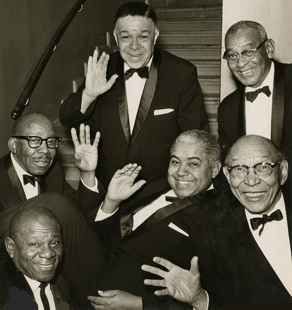 FAMOUS BASSIST Pops Foster (lower right), 1892-1969, was already playing professionally in New Orleans by 1907. Amid a busy career of touring and gigging with top jazz names, he lived mainly in New York and (eventually) San Francisco. He is shown here (bottom right) in a photo from his own collection with an all-star band that included New Orleans natives Alvin Alcorn (piano, bottom left) Alvin Alcorn (trumpet, center) and Cie Frazier (drums, top right). Photograph: San Francisco Traditional Jazz Foundation Collection, Archive of Recorded Sound, Stanford University (date unknown)