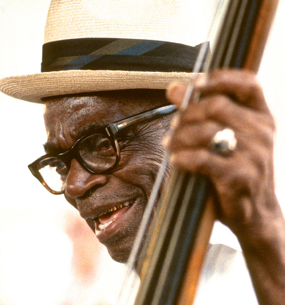 """IN PERPETUAL DEMAND around New Orleans, and on numerous road trips across the U.S. and Europe, muscular bassist Chester Zardis (1900-1990) employed a powerful style that belied his physical shortness of stature and earned him the nickname """"Little Bear."""" In the post-World War II years, younger proteges flocked to hear and meet early New Orleans masters like Zardis. Thus was a once-obscure, pre-electronic bass plucking technique revived and carried forward across generations and over continents. Photograph by William Carter, 1984"""